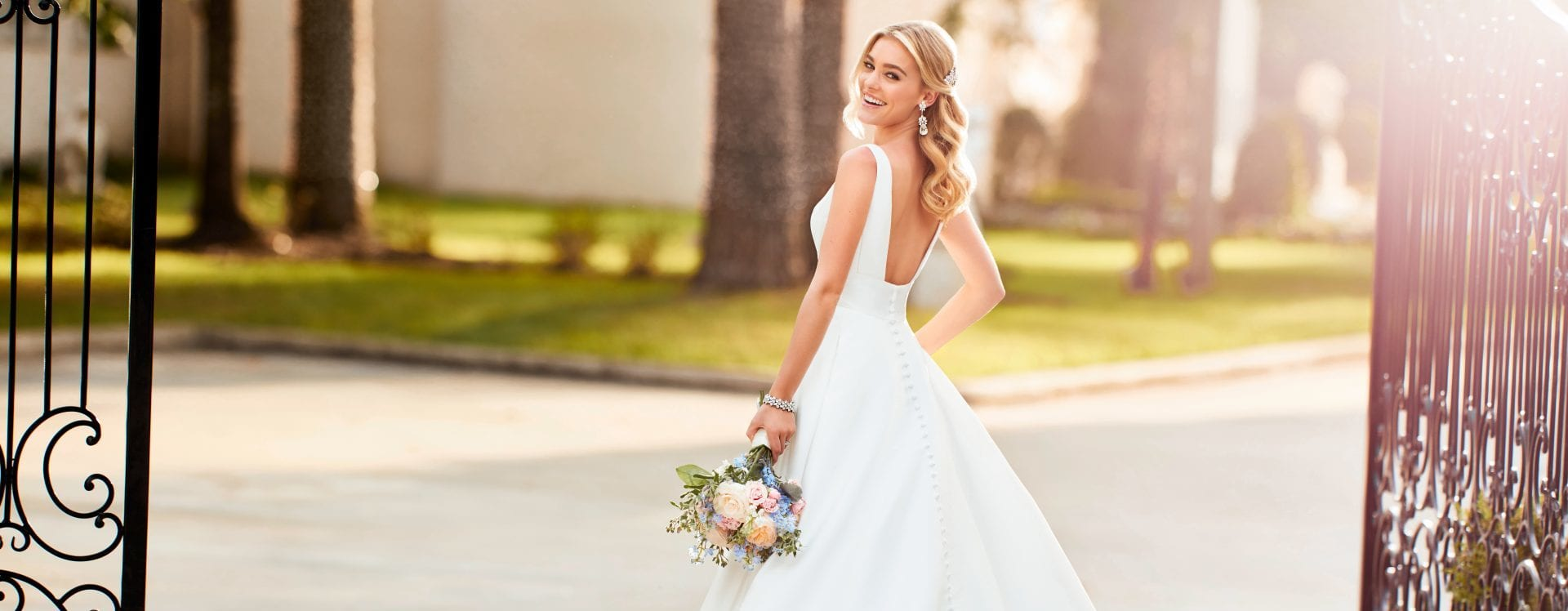 Image of Stella York Wedding Dress on Bride outside